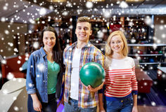 Happy friends in bowling club at winter season Royalty Free Stock Images