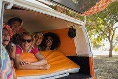 Happy friends in camper van Stock Image