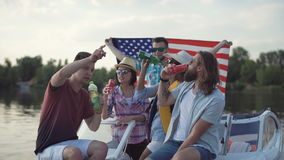 Happy friends celebrating Independence day. Young cheerful people toasting and taking selfie while celebrating Independence day on boat stock footage