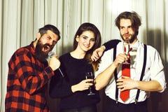 Happy friends celebrating at karaoke party Royalty Free Stock Image