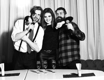 Happy friends celebrating at karaoke party Royalty Free Stock Photography