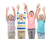 Happy friends celebrating victory. Childhood, fashion, gesture and people concept - happy smiling friends raising fists and celebrating victory Stock Photo