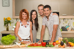 Happy friends cooking Stock Images