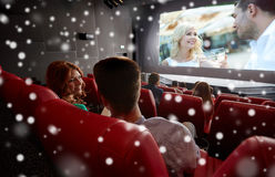 Happy friends or couple watching movie in theater Royalty Free Stock Photography