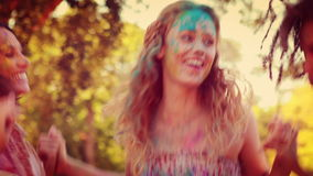Happy friends covered with powder paint in the park stock video footage