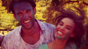 Happy friends covered with powder paint smiling at camera stock video