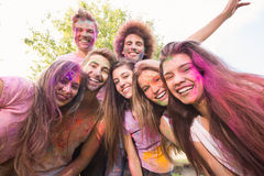Happy friends covered in powder paint Stock Images