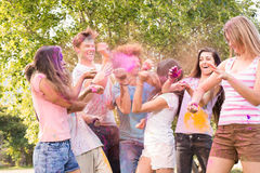 Happy friends covered in powder paint Stock Photo