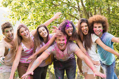 Happy friends covered in powder paint Royalty Free Stock Image