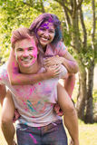Happy friends covered in powder paint Stock Image