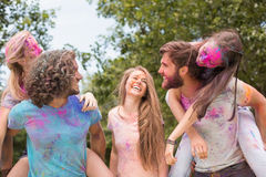 Happy friends covered in powder paint Stock Photography