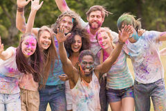 Happy friends covered in powder paint Royalty Free Stock Photography