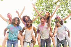 Happy friends covered in powder paint Stock Photos