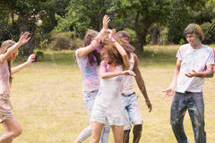 Happy friends covered in powder paint Royalty Free Stock Photo