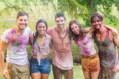 Happy friends covered in powder paint Royalty Free Stock Images