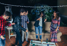 Happy friends dancing and having fun in a party Stock Photography