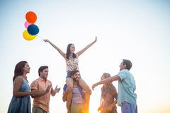 Happy friends dancing on the sand with balloon Royalty Free Stock Photo