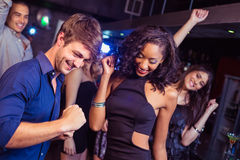 Happy friends dancing together Royalty Free Stock Images