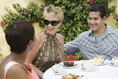 Happy Friends At Dinning Table Stock Image