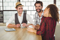 Happy friends discussing together Royalty Free Stock Photography
