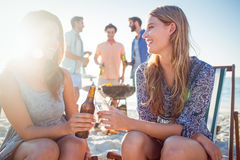 Happy friends doing barbecue and drinking beer Royalty Free Stock Images