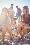 Happy friends doing barbecue and drinking beer Royalty Free Stock Photo
