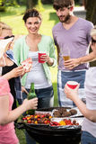 Happy friends doing barbecue Royalty Free Stock Image