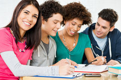 Happy Friends Doing Homework Stock Image