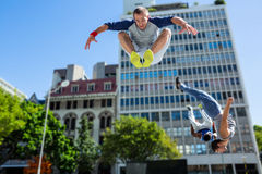 Happy friends doing parkour in the city Royalty Free Stock Image