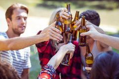 Happy friends drink beer in the park Stock Photo