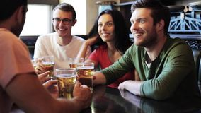 Happy friends drinking beer at bar or pub stock video