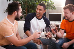 Happy friends drinking beer at home Stock Photo