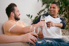 Happy friends drinking beer at home Royalty Free Stock Image