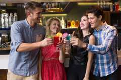 Happy friends drinking cocktails together Stock Photo
