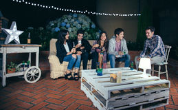 Happy friends drinking and having fun in a party royalty free stock photography
