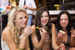 Happy friends drinking shots together Royalty Free Stock Photography