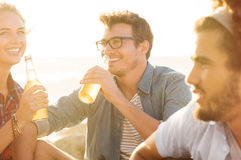 Happy friends drinking Stock Image