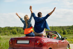Happy friends driving in cabriolet car at country Royalty Free Stock Photography