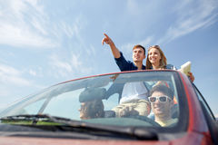 Happy friends driving in cabriolet car Stock Image