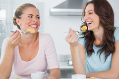 Happy friends eating cake and having coffee Royalty Free Stock Image
