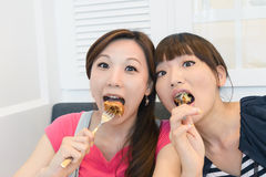 Happy friends eating Stock Image