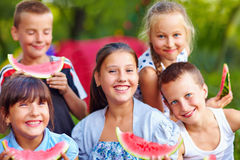 Happy friends eating watermelon, outdoors Royalty Free Stock Photos