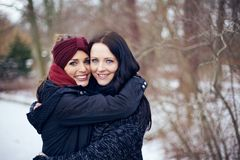 Happy Friends Embracing Each Other Outdoors Stock Image