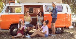 Happy friends enjoying at camper van Stock Photos