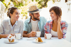 Happy friends enjoying coffee together Stock Photography