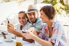 Happy friends enjoying coffee together Stock Photos