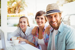 Happy friends enjoying coffee together Royalty Free Stock Photo