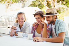 Happy friends enjoying coffee together Stock Images