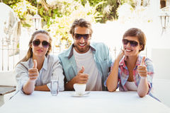 Happy friends enjoying coffee together Royalty Free Stock Image