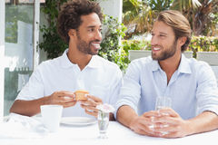 Happy friends enjoying coffee together Stock Image